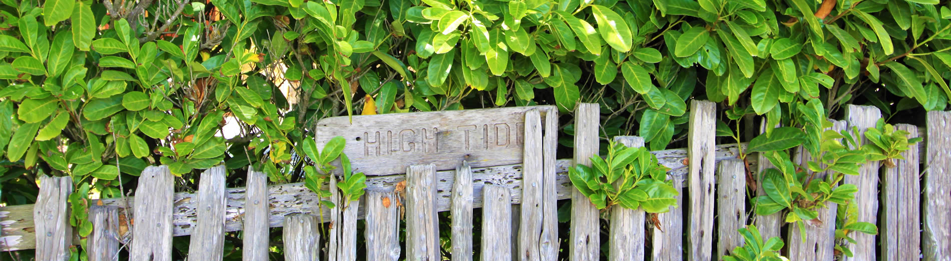 high tide cottages on tomales bay in marshall ca fence with sign